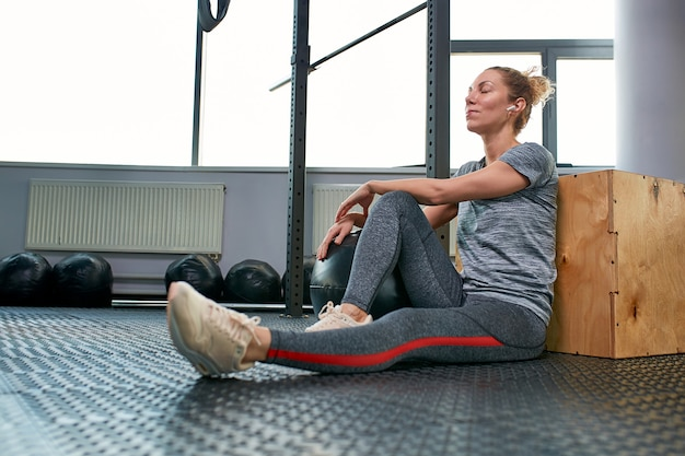 Woman doing exercises with fitball in fitness gym class