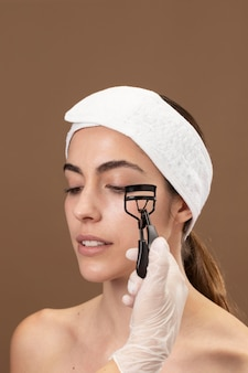 Woman doing an eyelashes treatment to her client