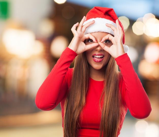 Woman doing finger glasses in the street