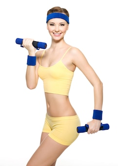 Woman doing fitness exercise with dumbbells isolated on white