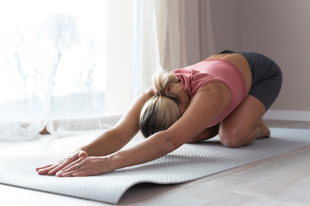 Woman doing fitness exercises and stretching