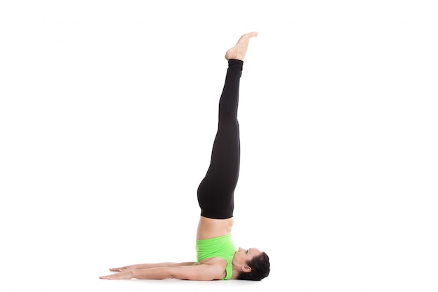 Woman doing a handstand resting on his neck