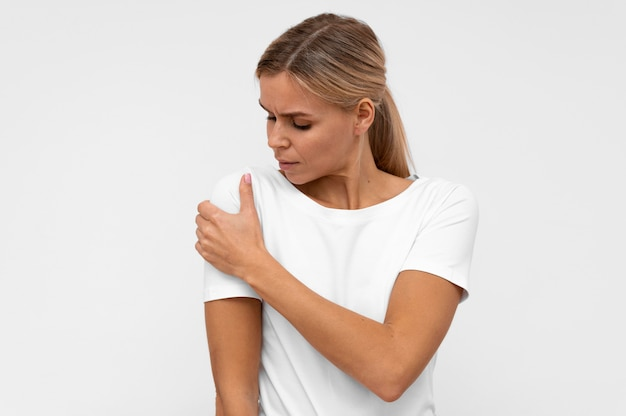 Woman doing having shoulder pain