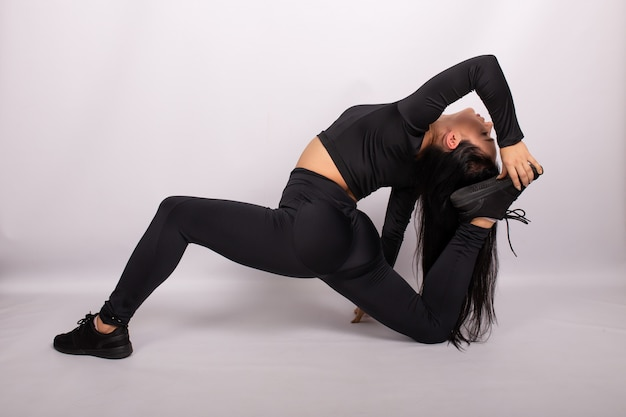 Woman doing leg exercise to stretch muscles. sport and fitness woman, yoga