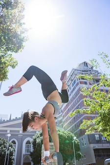 Woman doing parkour in the city