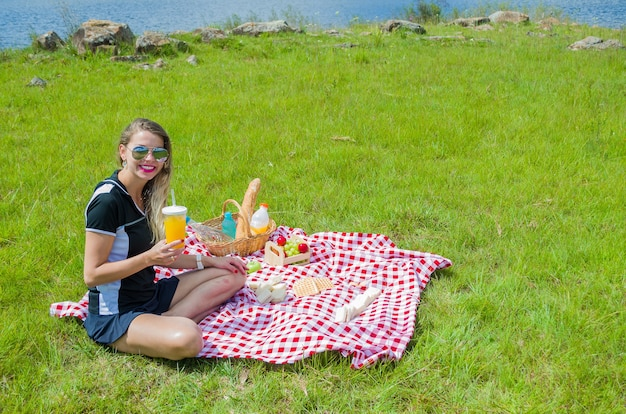 Woman doing picnic on green lawn