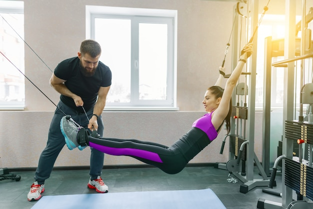 Woman doing rehabilitation exercises with personal instructor