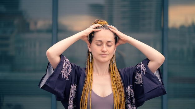 Woman doing self head massage closeup improve mental health