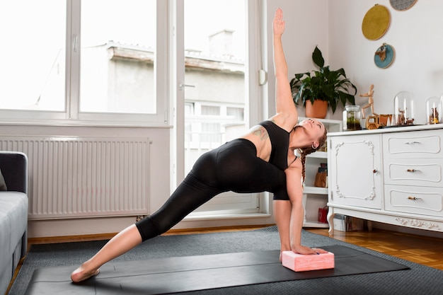 Woman doing side lunge sport at home concept