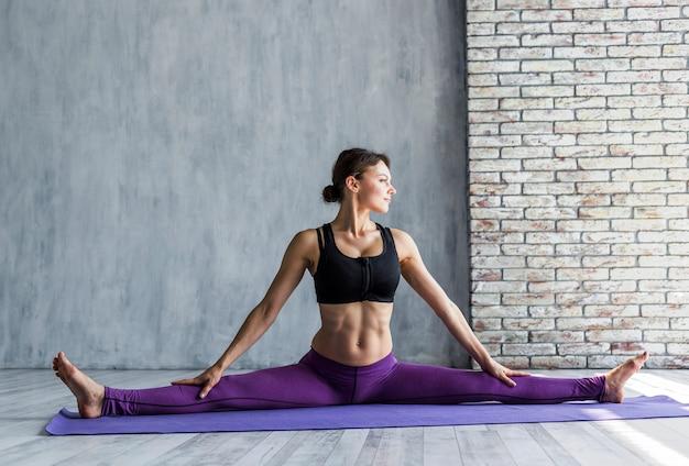 Woman doing a side split