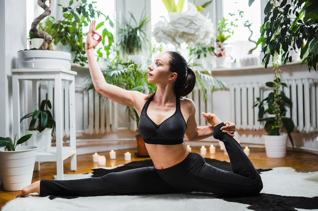 Woman doing split at home