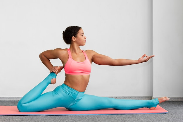Woman doing the splits and showing approval