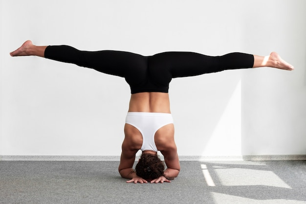 Woman doing the splits while standing on hands