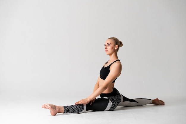 Woman doing the splits with white background