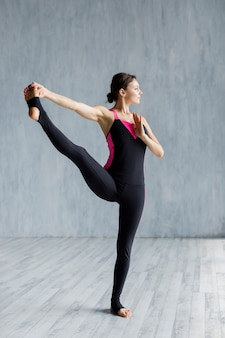 Woman doing a stretching exercise for legs