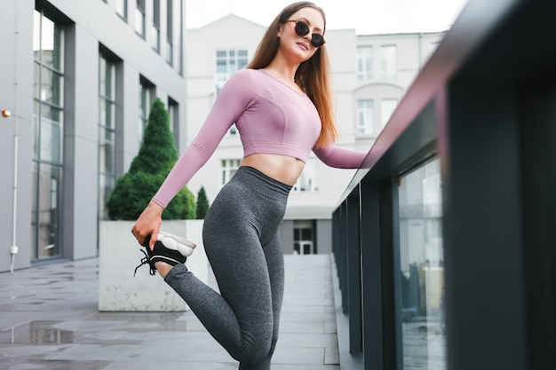 Woman doing stretching in the street