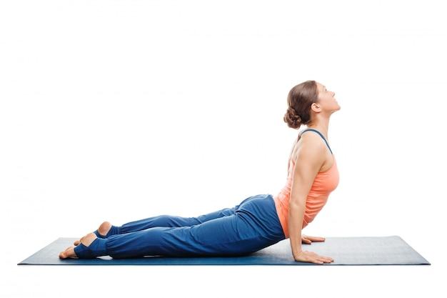 Woman doing surya namaskar sun salutation ashtanga vinyasa yoga