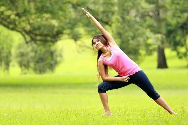 Woman doing workout on grass