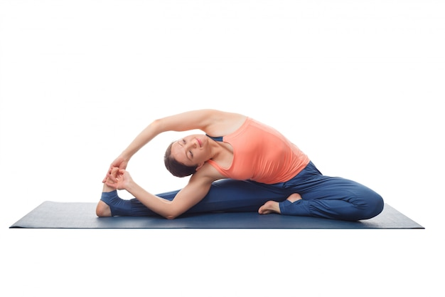 Woman doing yoga asana parivrtta janu sirshasana