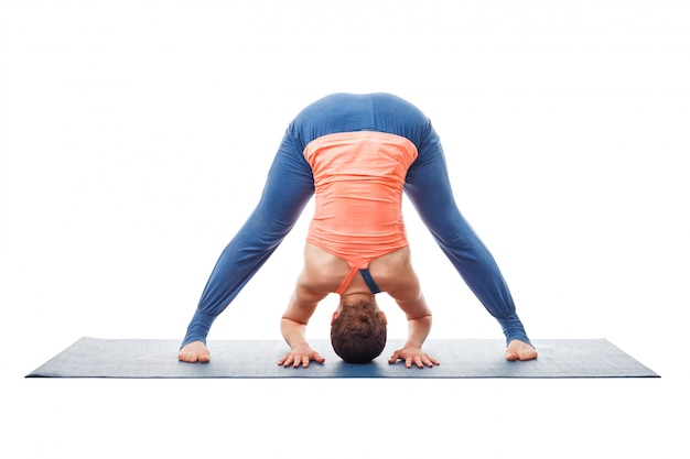 Woman doing yoga asana prasarita padottanasana