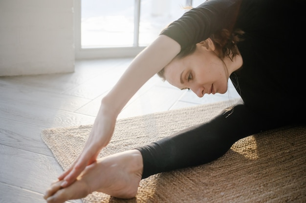 Woman doing yoga or fitness exercises
