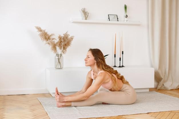 Woman doing yoga the living room