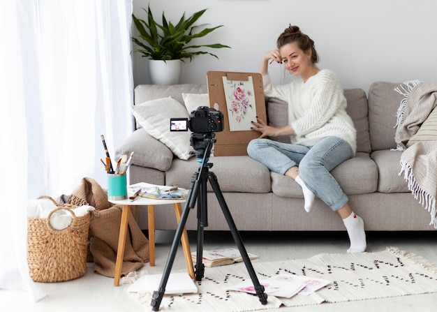 Woman drawing for an online tutorial at home