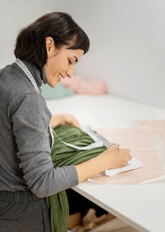 Woman drawing sketch of clothes