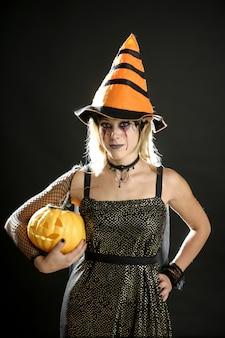 Woman dress for halloween and pumpkin