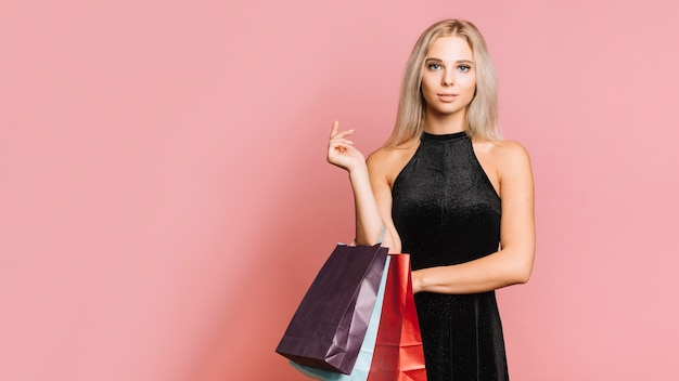 Woman in dress with shopping bags