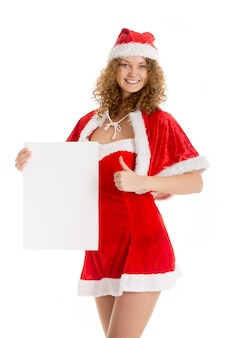 Woman dressed as santa with poster