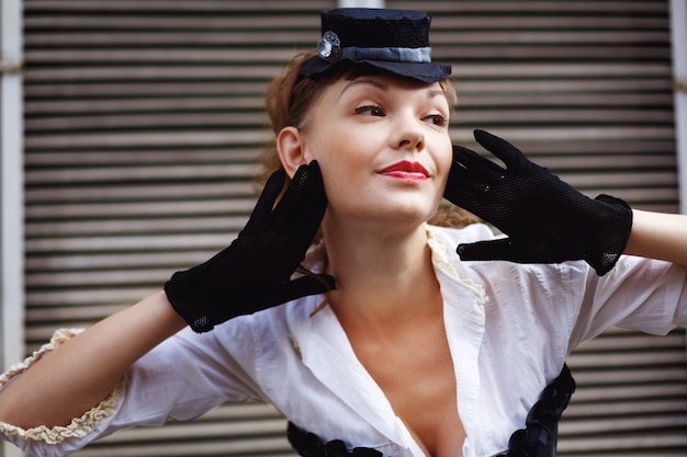 Woman dressed up in retro style posing