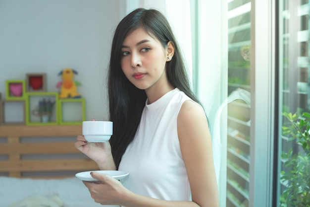 Woman drink a coffee on the morning