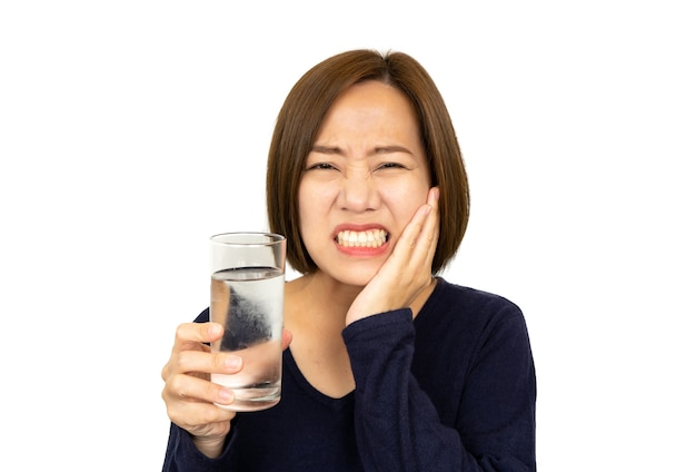 Woman drinking cold drink and feels pain,sensitive teeth concept