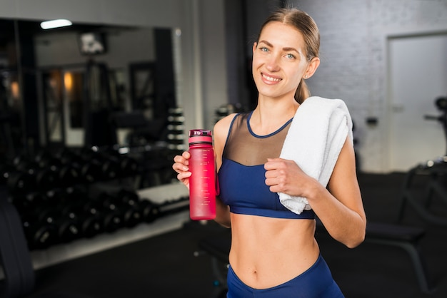 Woman drinking in gym