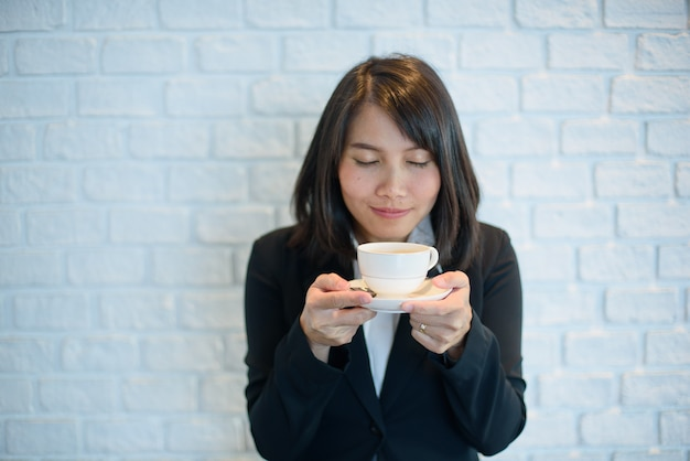 Woman drinking hot coffee at morning, relax time
