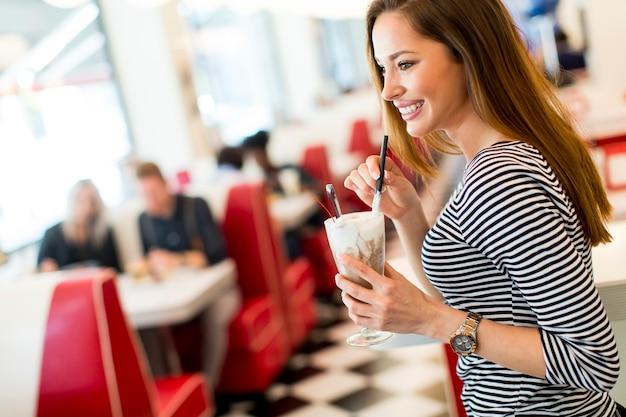 Woman drinking milkshake