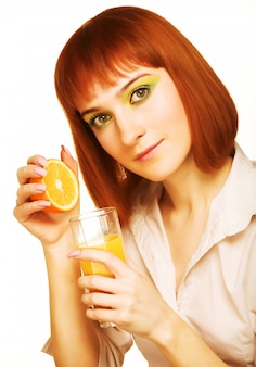 Woman drinking orange juice close up