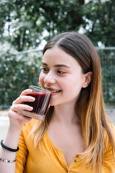 Woman drinking pomegranate juice