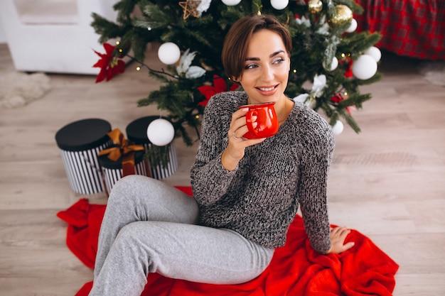 Woman drinking tea on christmas eve