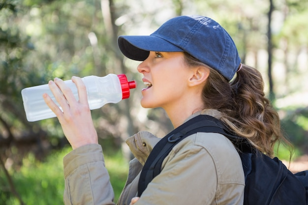 Woman drinking water while doing a break