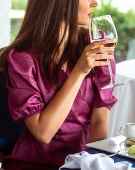 Woman drinking wine wine at the restaurant