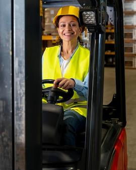 Woman driving warehouse loading machine