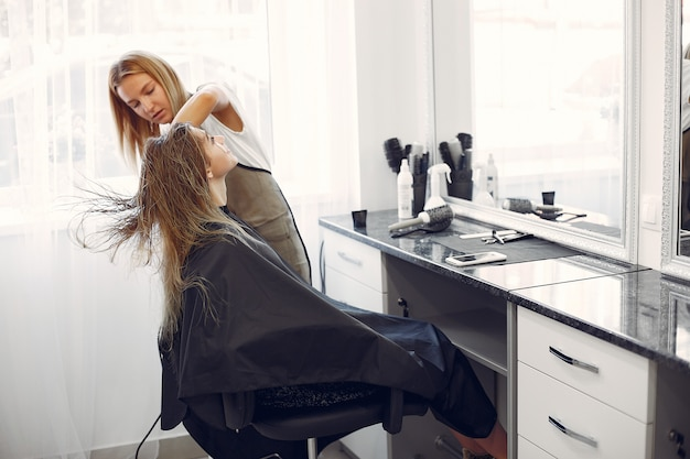 Woman drying hair in a hairsalon