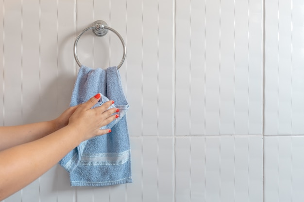 Woman drying hands with towel