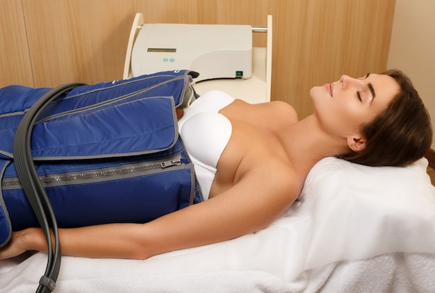 Woman during automatic lymphatic drainage