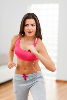 Woman during the cardio training at home