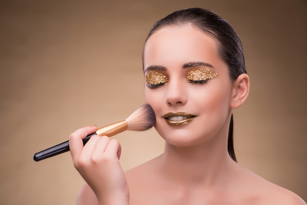 Woman during cosmetics session in fashion concept