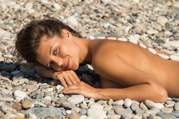 Woman during stone massage