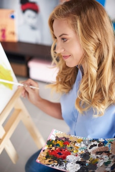 Woman next to the easel